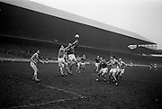 16/02/1964<br /> 02/16/1964<br /> 16 February 1964<br /> Railway Cup Football Semi Final: Munster v Ulster at Croke Park, Dublin. Ulster back L. Murphy (left) jumps to gather the ball falling into the hands of Munster forward, M. Burke.