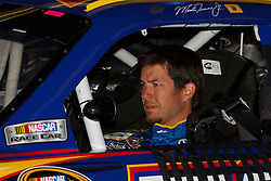 June 25, 2011; Sonoma, CA, USA;  Sprint Cup Series driver Martin Truex Jr. (56) sits in his car before practice for the Toyota/Save Mart 350 at Infineon Raceway.