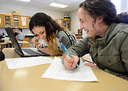 From left, Destini Rivera, 14 and Kayla Rowland, 14 work on a lab problem with a laptop during science class Friday, March 17, 2017 at Upper Perkiomen High School in Pennsburg, Pennsylvania. (WILLIAM THOMAS CAIN / For The Philadelphia Inquirer)