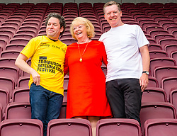 Pictured: Edinburgh Festival Fringe, Edinburgh, Scotland, United Kingdom, 02 August 2019. Photocall prior to this evening's Edinburgh International Festival Aberdeen Standard Investments Opening Event: LA Phil at Tynecastle, with conductor Gustavo Dudamel, owner of Hearts football Club, Ann Budge, and Fergus Linehan, Director of EIF ahead of the Aberdeen Standard Investments Opening Event: LA Phil at Tynecastle stadium.<br /> Sally Anderson | EdinburghElitemedia.co.uk
