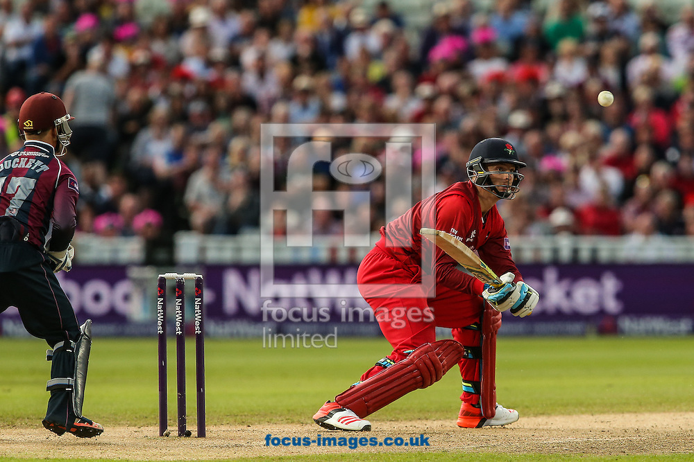 Jos Buttler of Lancashire Lightning (right)  tries a reverse sweep shot during the Natwest T20 Blast Final at Edgbaston, Birmingham<br /> Picture by Andy Kearns/Focus Images Ltd 0781 864 4264<br /> 29/08/2015