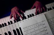 A musician plays piano at La Juliana, a top night club in Ecuador.