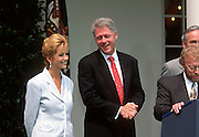 U.S. President Bill Clinton with celebrity Kathy Lee Gifford in the Rose Garden at the White House August 2, 1997 in Washington, DC.