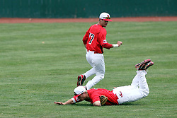 06 April 2013:  Centerfielder Chad Hinshaw runs in to attempt a catch of a short hit fly ball, Left Fielder Otto Roberts backs him up during an NCAA division 1 Missouri Valley Conference (MVC) Baseball game between the Missouri State Bears and the Illinois State Redbirds in Duffy Bass Field, Normal IL