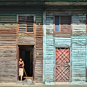 A decaying wood house, one of the few that still can be seen in Havana.