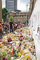 18 July 2017 taken between the hours of 15.51 - 16.49<br /> <br /> Grenfell Tower&rsquo;s memorial wall of hope. Showing both the grief and anger of the community.<br /> <br /> The Grenfell Tower fire occurred on 14 June 2017 at the 24-storey, 220-foot-high (67 m), tower block of public housing flats in North Kensington, Royal Borough of Kensington and Chelsea, West London. It caused at least 80 deaths and over 70 injuries. A definitive death toll is not expected until at least 2018. As of 5 July 2017, 21 victims had been formally identified by the Metropolitan Police. Authorities were unable to trace any surviving occupants of 23 of the flats. (Source Wikipedia}