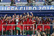 Portugal players lift the trophy and celebrate during the Euro 2016 final between Portugal and France at Stade de France, Saint-Denis, Paris, France on 10 July 2016. Photo by Phil Duncan.