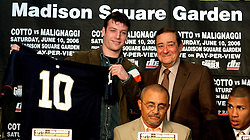 Promoter Bob Arum (r) presents middleweight John Duddy with a Notre Dame jersey at the press conference announcing his upcoming fight June 10, 2006 at Madison Square Garden. The fight will take place on the undercard of the Miguel Cotto-Paulie Malignaggi WBO Jr. Welterweight Championship fight.