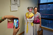 An amateur actress of a Shatin based opera company has her picture taken with her mother who came to see her performing