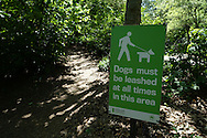 Signage in Central Park: Dogs must be leashed at all times in this area.