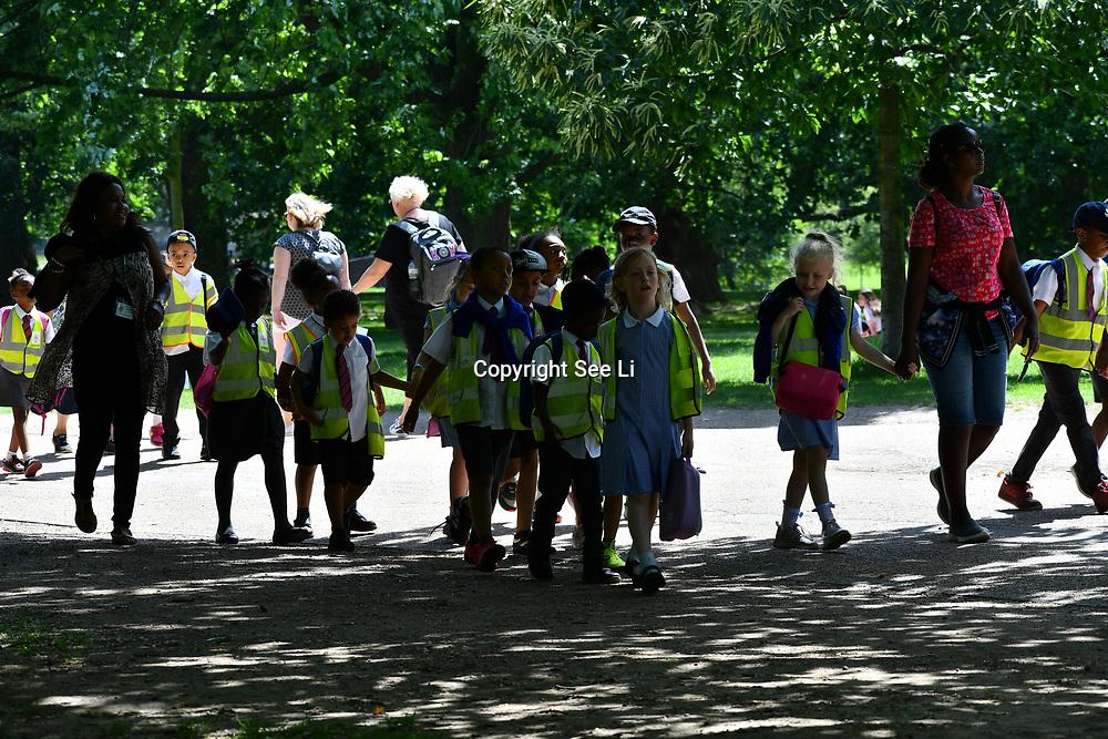 London, UK. 27 June 2019. UK Weather - The Hottest week in June 2019 Teachers taking school children for a walk at Green Park, London, UK