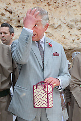 The Prince of Wales reacts as he is presented with a gift during a visit to the Ras Al Shajar nature reserve in south east Oman during his official tour of the Middle East.