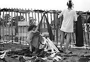 Child playing with rip stock fabric, Glastonbury, Somerset, 1989