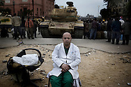 A doctorsits on a chair in  Tahrir Square in Cairo on February 5, 2011  © ALESSIO ROMENZI