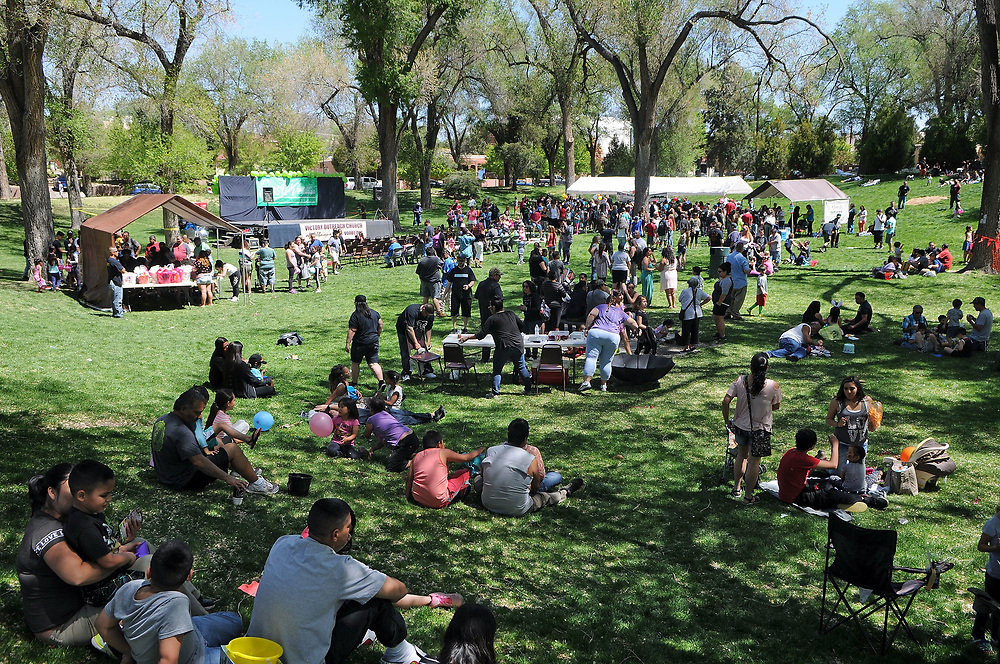 jt041517h/a sec/jim thompson/ A good sized crowd was forming at the Victory Outreach Albuquerque Church's HOPE Easter Egg Hunt and care Basket Giveaway at Roosevelt Park.  Saturday April 15, 2017. (Jim Thompson/Albuquerque Journal)