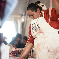 Miss Navajo Nation Pageant contestant Kayla Martinez of Window Rock cleans sheep intestines to prepare ach'íí during the butchering competition Monday, Sept. 2 in Window Rock at the Navajo Nation Fair.