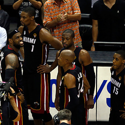 Jun 16, 2013; San Antonio, TX, USA; Miami Heat center Chris Bosh (1) and small forward LeBron James (6) and shooting guard Ray Allen (34) and shooting guard Dwyane Wade (3) and point guard Mario Chalmers (15) react during the fourth quarter of game five in the 2013 NBA Finals against the San Antonio Spurs at the AT&T Center. Mandatory Credit: Derick E. Hingle-USA TODAY Sports