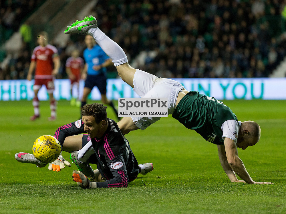 Hibernian FC v Aberdeen FC<br /> <br /> Danny Ward gets to ball before David Gray (Hibernian captain) during the Scottish League Cup clash between Hibernian and Aberdeen FC at Easter Road Stadium on 23 September 2015.<br /> <br /> <br /> <br /> Picture Alan Rennie.