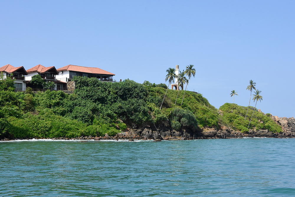 The coast line of trees and a house in Mirissa, Sri Lanka