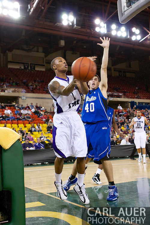 November 27th, 2010:  Anchorage, Alaska - Weber State junior guard Damian Lillard (1) attempts a baseline pass in the Wildcats 82-81 victory over the Drake Bulldogs in the third place game of the Great Alaska Shootout.