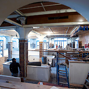 """February 27, 2013 - New York, NY : American chef and restaurateur Andrew Carmellini plans to open """"Lafayette,"""" an expansive French restaurant and bakery, at 380 Lafayette Street in NoHo, in April. Pictured here, the under-construction space seen from a cutout which will house a large semi-transparent clock. CREDIT: Karsten Moran for The New York Times"""