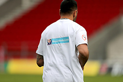 Catalan Dragons players wear anti knife t-shirts during the Betfred Super League match at the Totally Wicked Stadium, St Helens. PRESS ASSOCIATION Photo. Picture date: Thursday May 3, 2018. See PA story RUGBYL St Helens. Photo credit should read: Richard Sellers/PA Wire. RESTRICTIONS: Editorial use only. No commercial use. No false commercial association. No video emulation. No manipulation of images.