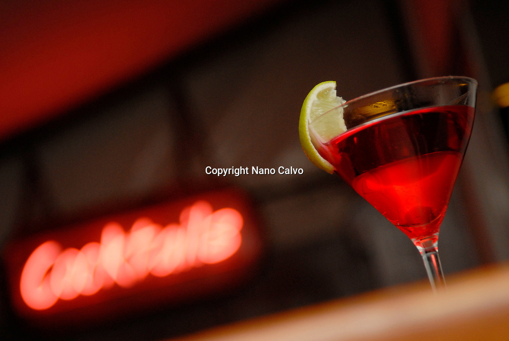 Red cocktail in a night bar Photo by Nano Calvo -Visual&Written