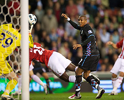 STOKE, ENGLAND - Monday, September 13, 2010: Aston Villa's Ashley Young sees his effort saved by Stoke City's goalkeeper Thomas Sorensen during the Premiership match at the Britannia Stadium. (Photo by David Rawcliffe/Propaganda)