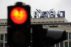 Dexia bank's logo is seen behind a red traffic light in Brussels, capital of Belgium on Oct. 9, 2011. Belgian and French governments were set to finalize break-up negotiations of Dexia, the first bank to fall victim to the euro zone sovereign debt crisis on Sunday. Photo by Xinhua/Imago/i-Images