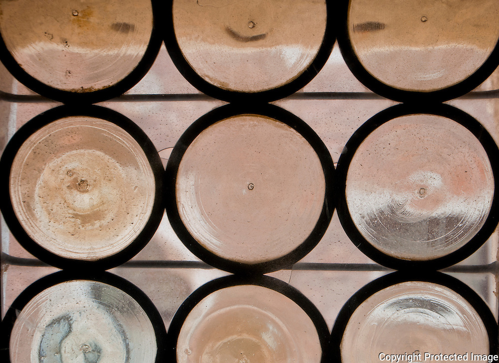 Detail of an antique leaded glass pattern in a Palazzo in Venice, Italy.