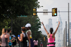 Runners take over North Broad St. during Philly Free Streets, on Saturday. (Bastiaan Slabbers for WHYY)