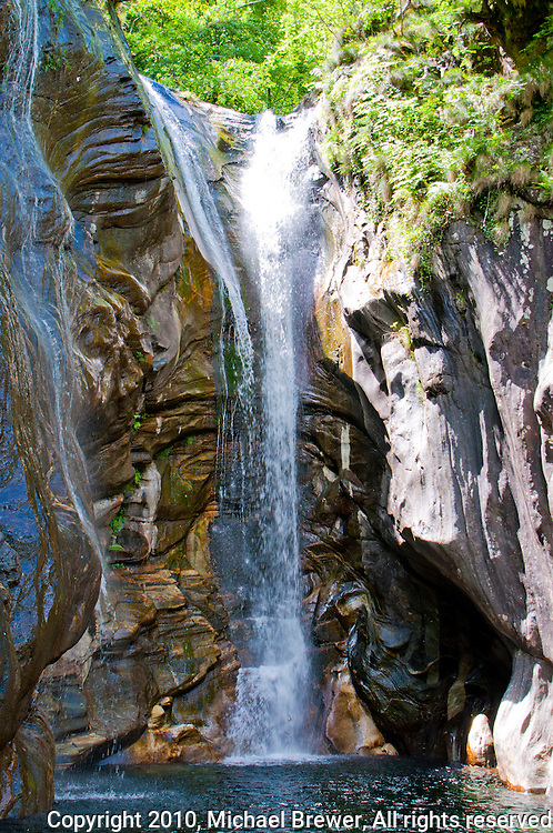 Magnificent waterfall plunging into a pool at Aurigeno, Ticino, Switzerland.