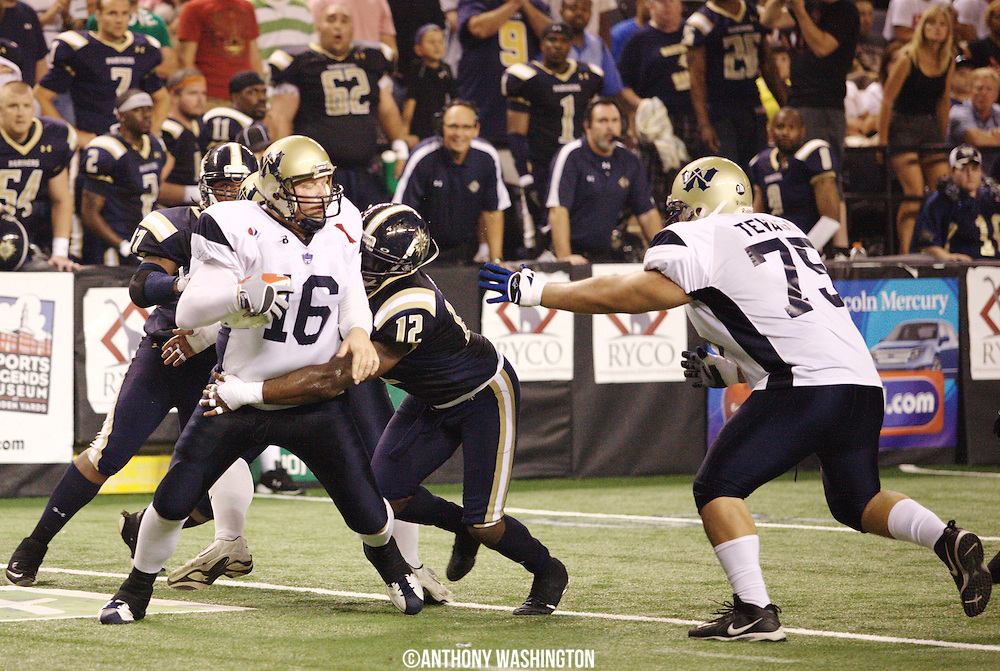 Wyoming Cavalry quarterback Matt Strand (No.16) is sacked by Baltimore Mariners defensive end Fearon Wright (No.12) during the AIFA Bowl IV at the 1st Mariner Arena on Sunday, July 25, 2010 in Baltimore, MD.