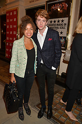 LUKE NEWBERRY and ANTONIA THOMAS at the West End opening night of 'Great Britain' a  play by Richard Bean held at The Theatre Royal, Haymarket, London followed by a post show party at Mint Leaf, Suffolk Place, London on 26th September 2014.