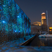 The MUCEM museum and Fort Saint-Jean at night in the Vieux-Port, or Old Port, of Marseille, France.