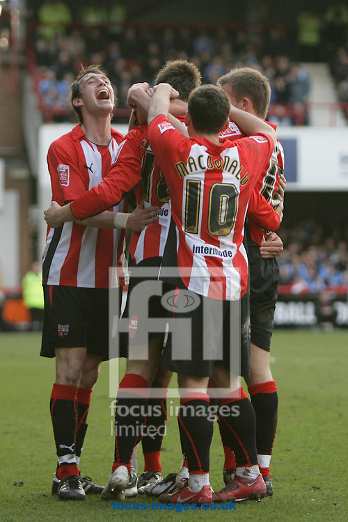London - Saturday, March 14th, 2009: Brett Johnson (L) of Brentford celebrates with goalscorer Sam Williams (C) and Charlie MacDonald during the Coca Cola League Two match at Griffin Park, London. (Pic by Mark Chapman/Focus Images)