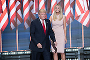 GOP Presidential candidate Donald Trump enters the stage greeting his daughter Ivanka Trump to accept the party nomination for president on the final day of the Republican National Convention July 21, 2016 in Cleveland, Ohio.