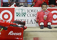 Dario Franchitti sits against the wall before the start of the IZOD IndyCar Iowa Corn Indy 250 auto race at the Iowa Speedway in Newton, Iowa on Saturday, June 23, 2012.