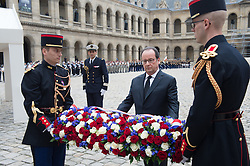 French President Francois Hollande lays a wreath during a national tribute to Harkis - Muslim Algerians who served as Auxiliaries in the French Army during the Algerian War from 1954 to 1962 - at Hotel des Invalides in Paris, France on September 25, 2016. Photo by Chamussy/Pool/ABACARESS.COM