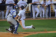 Mississippi's Kevin Mort scores vs. St. Louis at Oxford-University Stadium in Oxford, Miss. on Wednesday, March 24, 2010. Ole Miss won 14-5 to improve to 17-5 on the year.