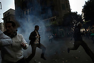 EGYPT, Cairo : Egyptian protesters run for cover  during clashes with security forces near the Interior Ministry in Cairo, Egypt, Saturday, Feb. 4, 2012..