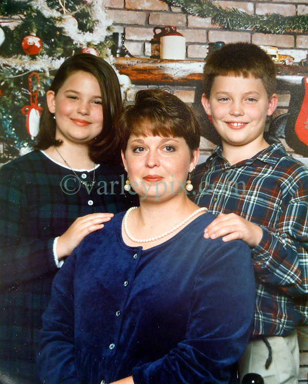 21 May 2015. Laurel, Mississippi.<br /> Collect photos of plus size model Tess Holliday (formerly known as Tess Munster, n&eacute;e Ryann Hoven) in her formative years from a family album. Tass and brother Tad Hoven with mother Beth.<br /> Photo credit; Tadlock via Varleypix.com
