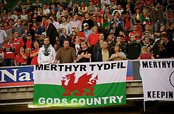 CARDIFF, WALES - Saturday, October 11, 2008: Wales supporters with a 'Merthyr Tydfil God's Country' banner during the 2010 FIFA World Cup South Africa Qualifying Group 4 match against Liechtenstein at the Millennium Stadium. (Photo by David Rawcliffe/Propaganda)