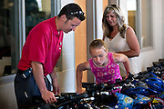Parker Toyota Salesman Blake Owens, left, helps excited fifth grader Kinsie Jones, right, pick out her perfect bicycle and helmet during the Perfect Attendance Spells Success (PASS) bike give-away on Sunday. This year marks the 6th year that PASS has worked with Parker Toyota and Horace Mann Insurance to provide new bikes and helmets to fifth and sixth graders with perfect attendance in the Coeur d'Alene, Post Falls and Lakeland School Districts.