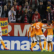 Omar Cummings, (right), Houston Dynamo, celebrates his winning goal during the New York Red Bulls V Houston Dynamo, Major League Soccer second leg of the Eastern Conference Semifinals match at Red Bull Arena, Harrison, New Jersey. USA. 6th November 2013. Photo Tim Clayton