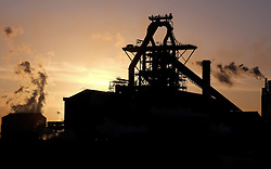 © Licensed to London News Pictures. <br /> 16/01/2015. <br /> <br /> South Gare, United Kingdom<br /> <br /> An early morning sunrise silhouettes the steel works at South Gare on Teesside.<br /> <br /> Photo credit : Ian Forsyth/LNP