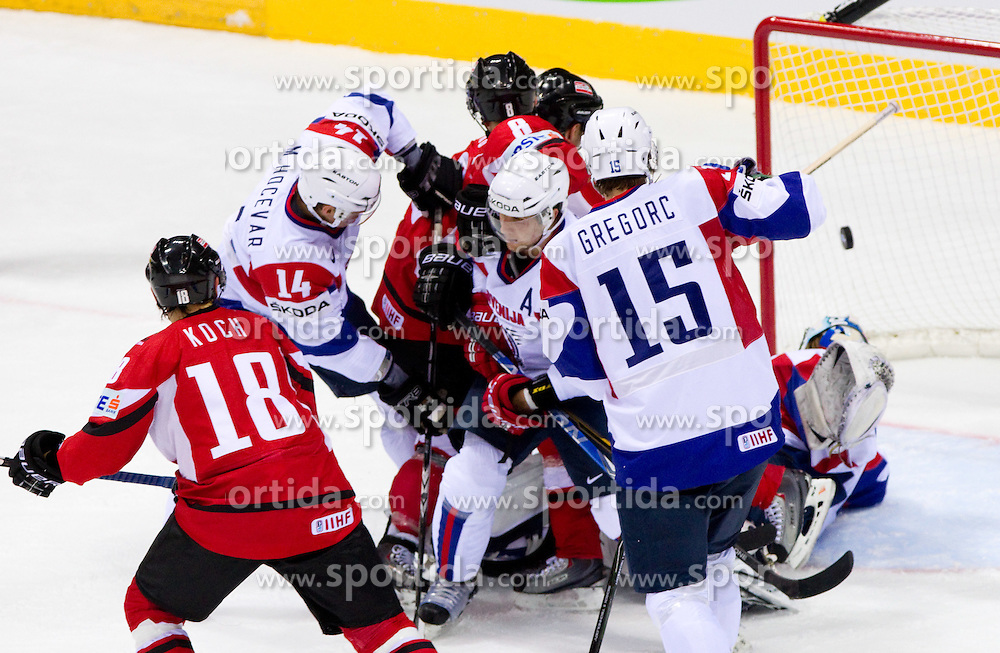Thomas Koch of Austria, Matej Hocevar of Slovenia, Roland Kaspitz of Austria, Mitja Robar of Slovenia and Blaz Gregorc of Slovenia during ice-hockey match between Austria and Slovenia of Group G in Relegation Round of IIHF 2011 World Championship Slovakia, on May 7, 2011 in Orange Arena, Bratislava, Slovakia. (Photo By Vid Ponikvar / Sportida.com)