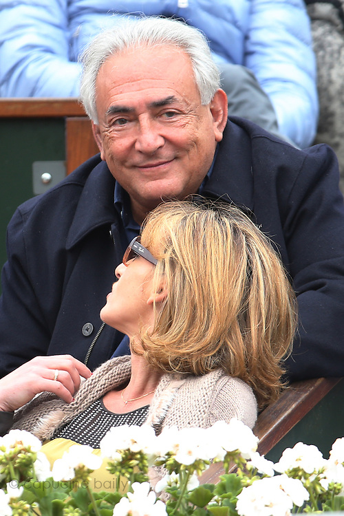 Paris, France. Roland Garros. June 9th 2013. Men's final.<br /> Dominique Strauss Kahn and Myriam L'Aouffir