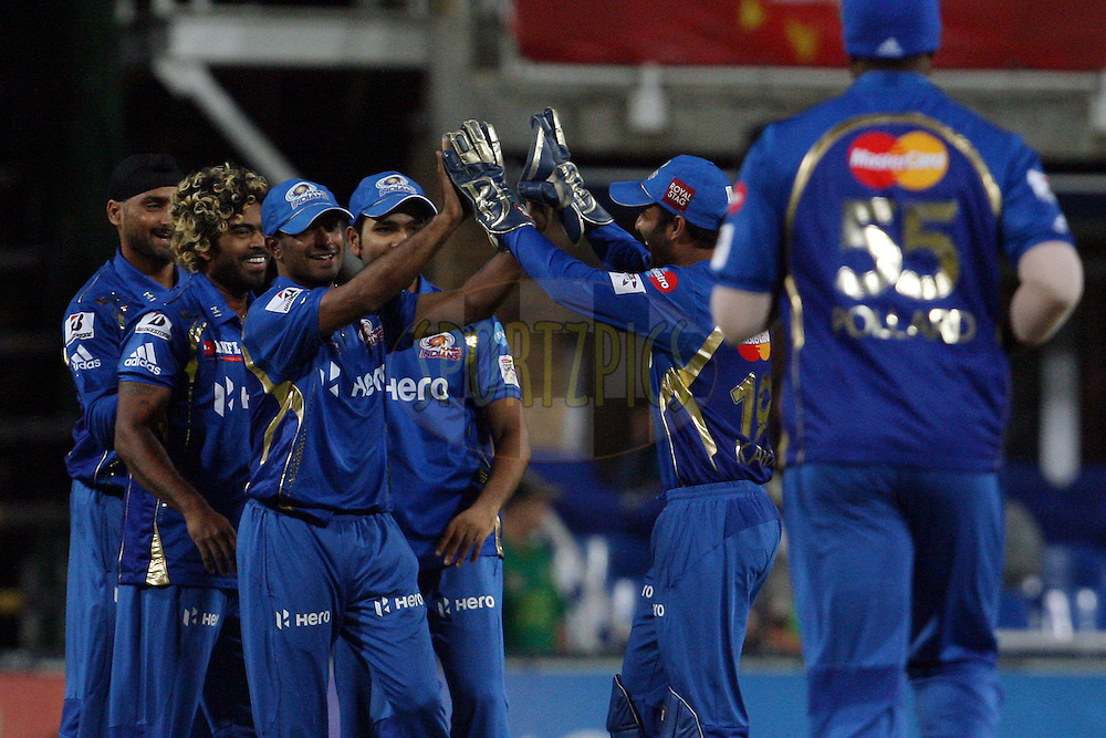 Mumbai Indians celebrate the wicket of Alviro Petersen during match 4 of the Karbonn Smart CLT20 South Africa between Mumbai Indians and Highveld Lions held at Wanderers Stadium, South Africa on the 13th October 2012. Photo by Jacques Rossouw/SPORTZPICS/CLT20