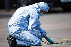 TA forensic investigator takes measurements at the scene at the intersection of Cole Crescent and Scott Crescent in Harrow where a 17-year-old was stabbed on the night of Sunday 10th June, leaving him in critical condition. June 11 2018.